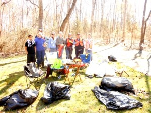 Ten volunteers (eight shown here) cleaned up the creek that runs to Parkwood Lake
