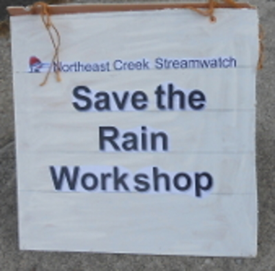 sandwich sign that says Northeast Creek Streamwatch Save the Rain Workshop
